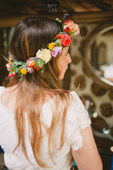 July 1, 2017 - Dordogne, France: Bride with crown of fresh flowers in her hair