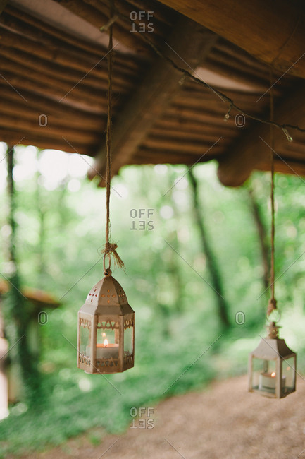 Lanterns hanging from rustic log roof