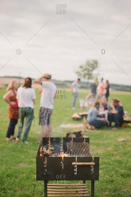 Grill by people in rural field