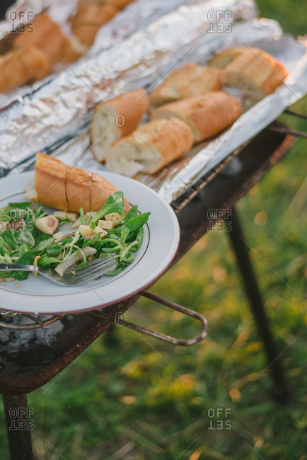 Bread and salad on a grill