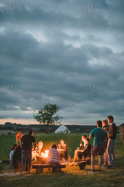 People around a rural campfire