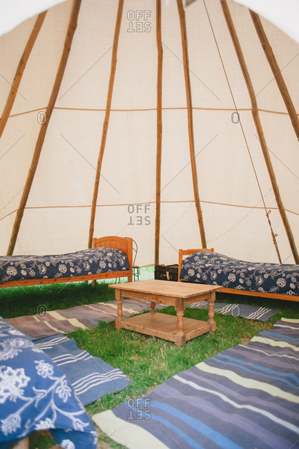 Beds underneath a yurt tent