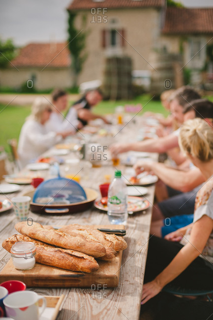 People eating at outdoor table