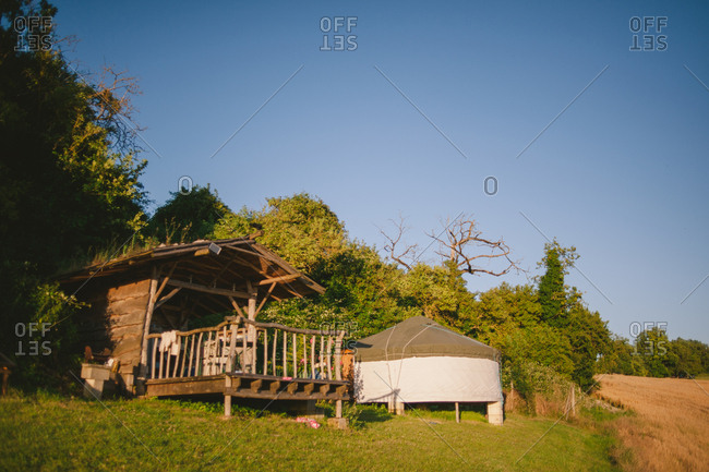 Covered deck and yurt in rural setting