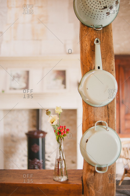 Rustic pots hanging in farmhouse