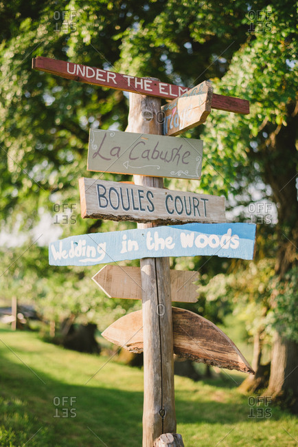 Hand painted signpost in rural setting