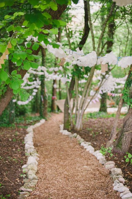 Decorative strings over wooded path