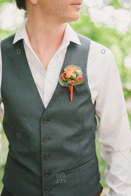 Groom in a vest with boutonniere