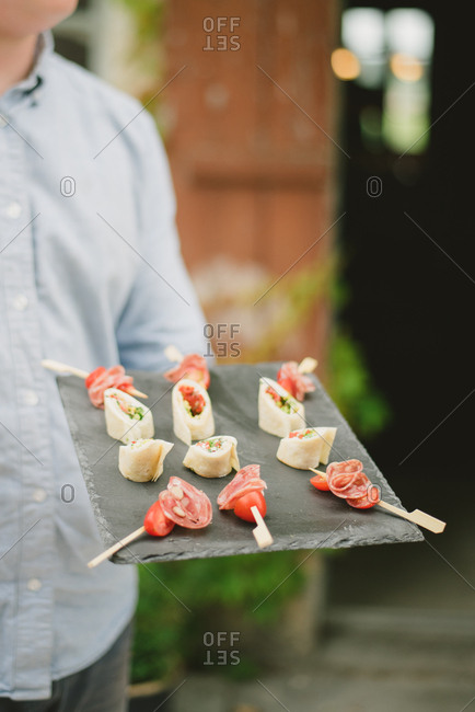 Caterer with food at outdoor wedding