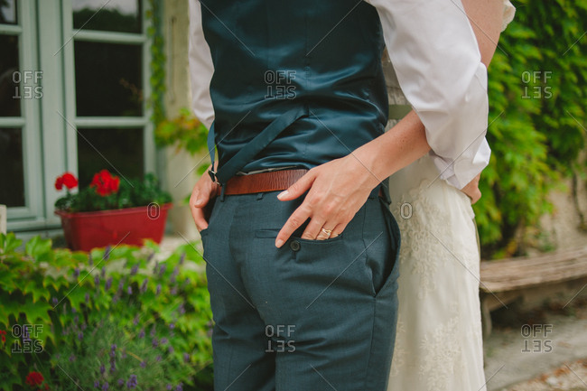 Bride with hands in groom's back pockets