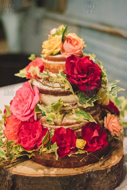 Cake on log with flowers