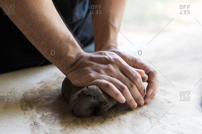 Man molding clay in a pottery and ceramic studio in Chiang Mai, Thailand