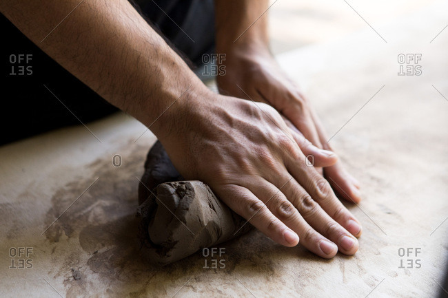 Hands molding clay in a pottery and ceramic studio in Chiang Mai, Thailand