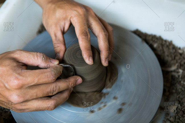 Hands spinning pottery in a ceramic studio in Chiang Mai, Thailand