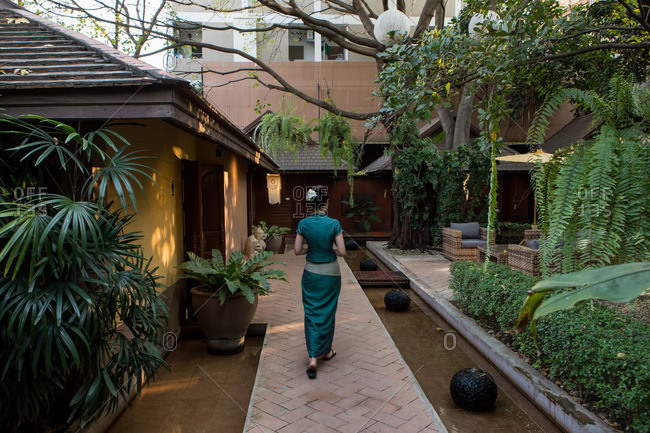 Woman walking at a health and massage spa in Chiang Mai, Thailand
