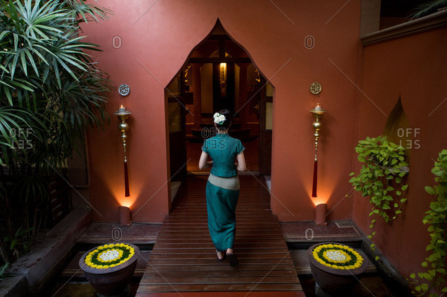 Woman walking into a health and massage spa in Chiang Mai, Thailand