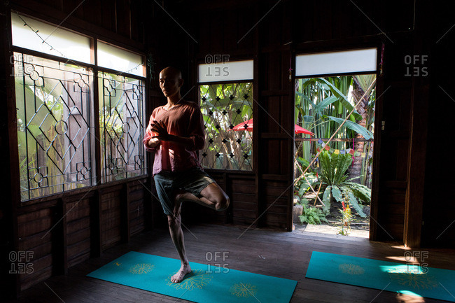 Chiang Mai, Thailand - March 5, 2017: Man posing in a yoga studio in Chiang Mai, Thailand