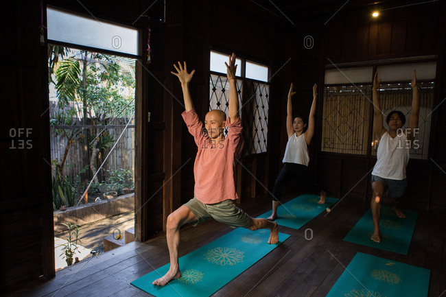Chiang Mai, Thailand - March 5, 2017: Man teaching class in a yoga studio in Chiang Mai, Thailand