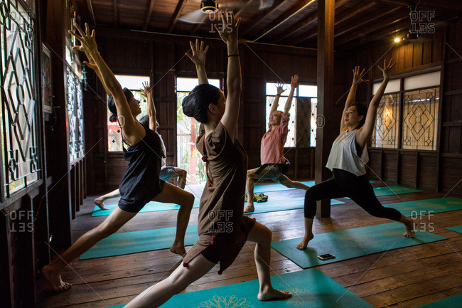 Chiang Mai, Thailand - March 5, 2017: Man teaching a yoga class in a yoga studio in Chiang Mai, Thailand