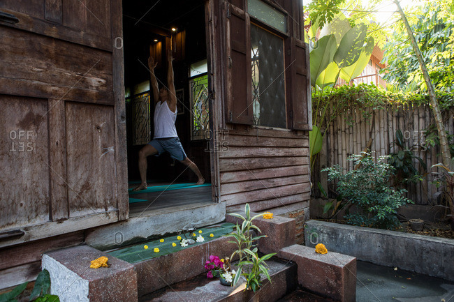 Chiang Mai, Thailand - March 5, 2017: View of a man doing yoga poses in a yoga studio in Chiang Mai, Thailand