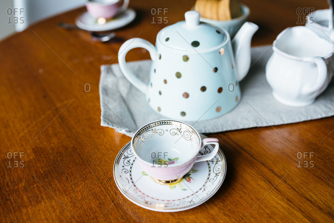 Teacups and teapot on dining room table