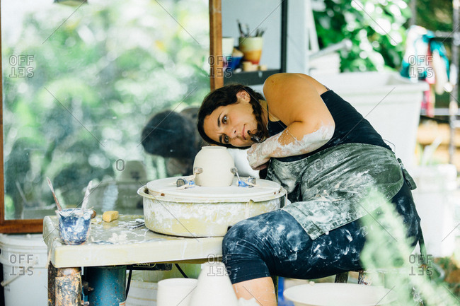 Woman making a clay pot