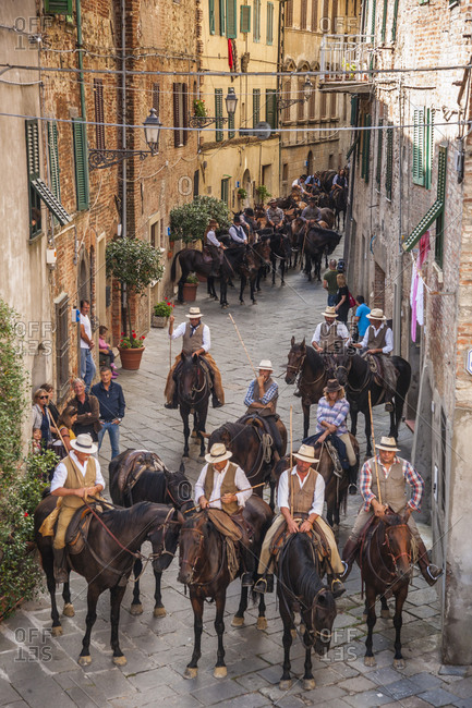 "Italy, Tuscany, Chiusdino - September 15, 2015: Chiusdino, passage of ""Transumando"", traveling on horseback and leading the cattle grazing across the region"