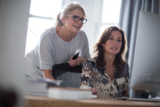 Mature businesswomen working together