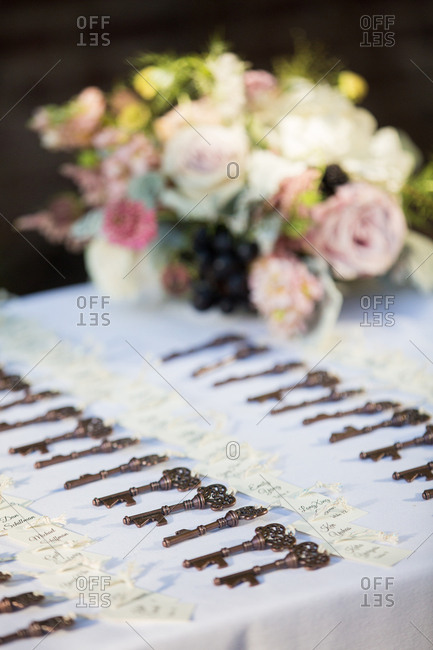 Keys with wedding guest names on a table