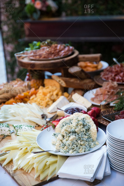 Reception table spread with a variety of cheeses and meats