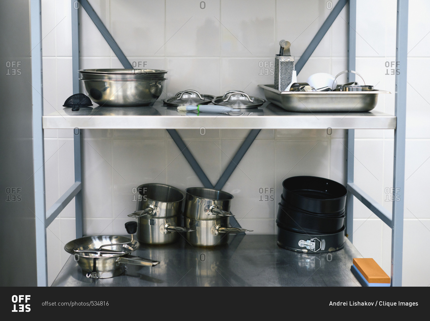Restaurant Kitchen Metal Shelves utensil in restaurant kitchen: steel saucepans, bowls, covers and