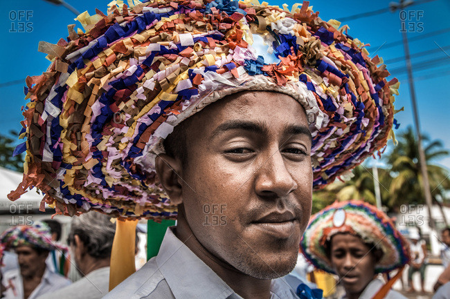 Salvador, Brazil - January 15, 2009: Man wearing a colorful hat with curled paper