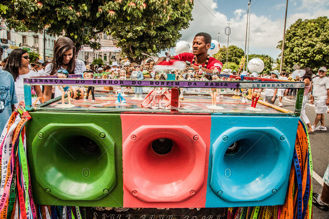 Salvador, Brazil - January 15, 2009: People standing around colorful loudspeakers at a festival