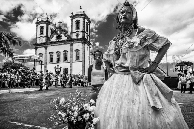 Salvador, Brazil - January 15, 2009: Woman standing in the street in front of Bonfim Church with her hands on her hips