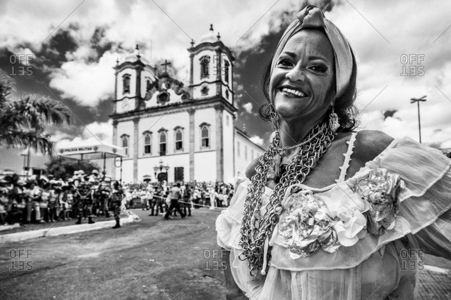 Salvador, Brazil - January 15, 2009: Woman standing in the street in front of the Bonfim Church