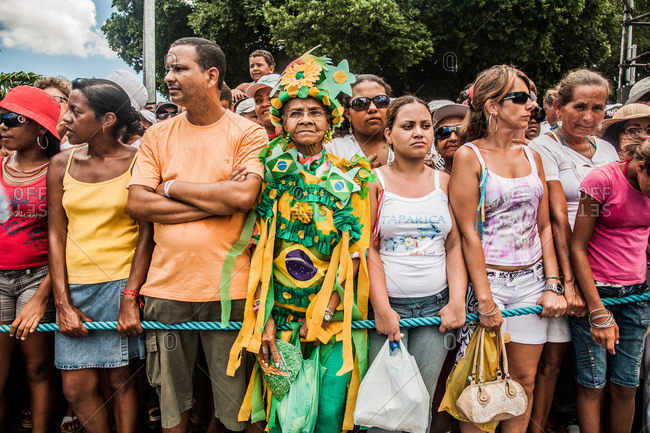 Salvador, Brazil - January 15, 2009: Senior woman in costume standing in a crowd of festival-goers