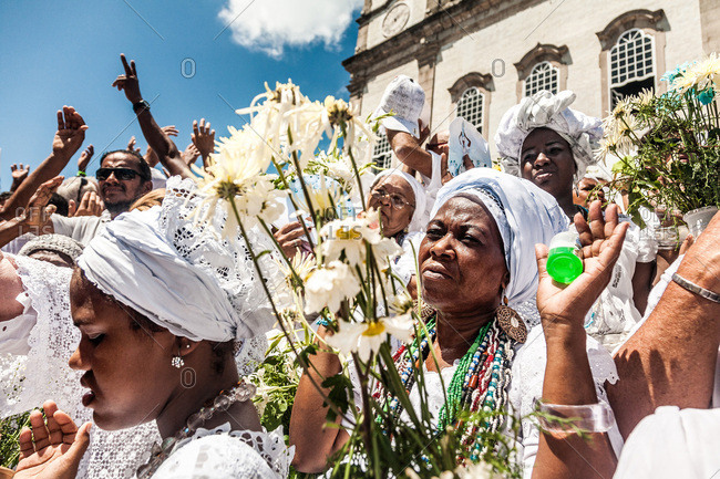 Salvador, Brazil - January 15, 2009: People holding flowers and celebrating in front of the Bonfim Church