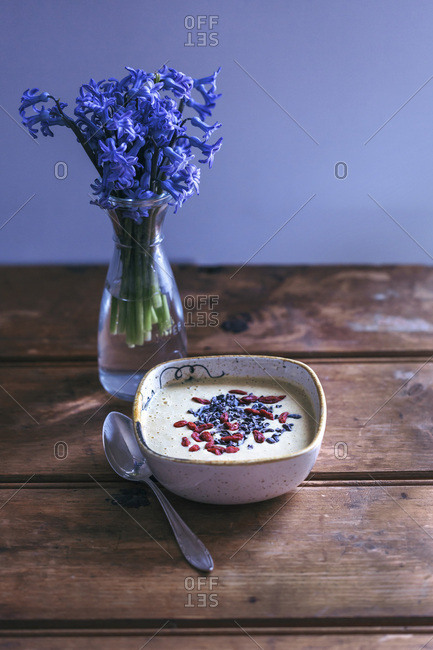 Banana smoothie bowl topped with goji berries and cacao nibs