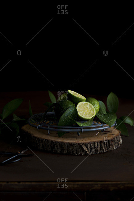 Chopped limes on a wooden chopping board