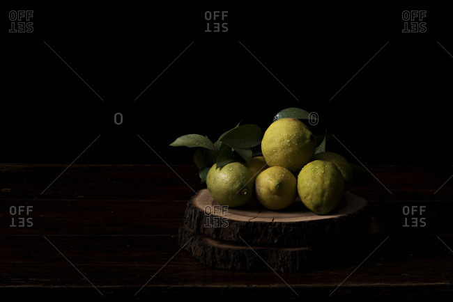 Chopped lemons on a wooden chopping board