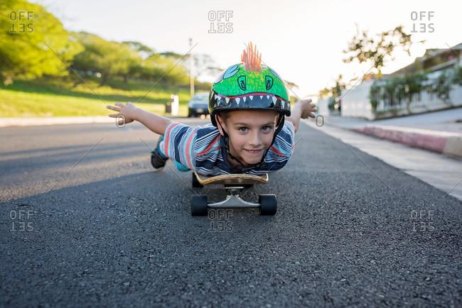 Boy lying on a skateboard