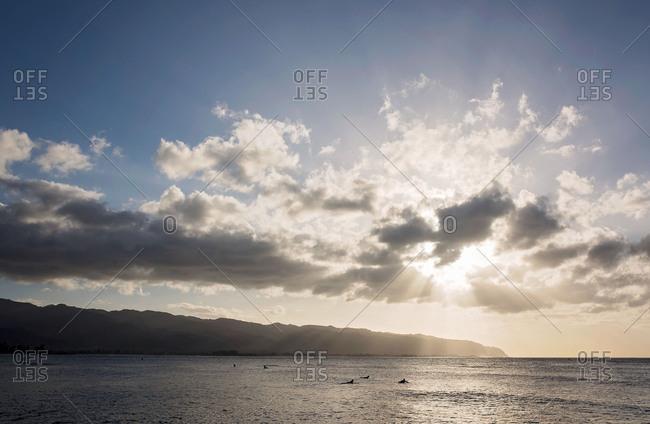 Sunburst over coastal setting