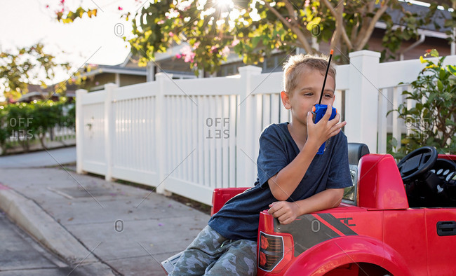 Boy playing with walkie talkie