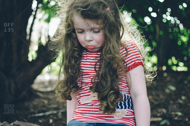 Girl pouting in a wooded setting