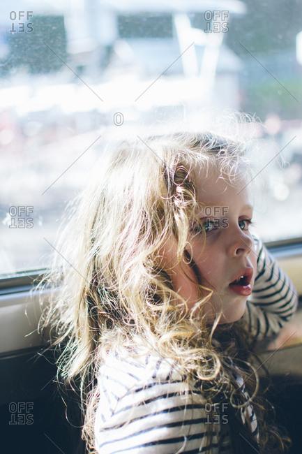 Girl by window staring away