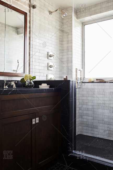 Los Angeles, California - November 15, 2016: Sink and walk in shower in bathroom