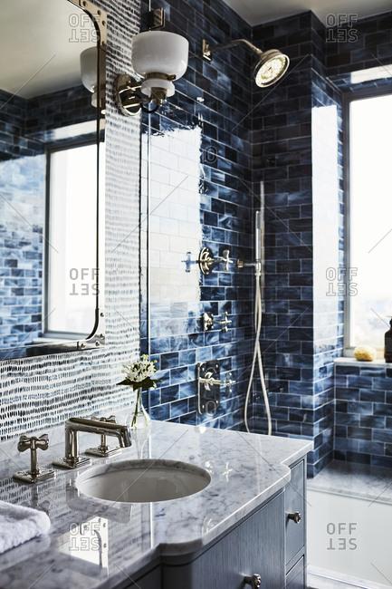 Los Angeles, California - November 15, 2016: Sink area in a tiled bathroom