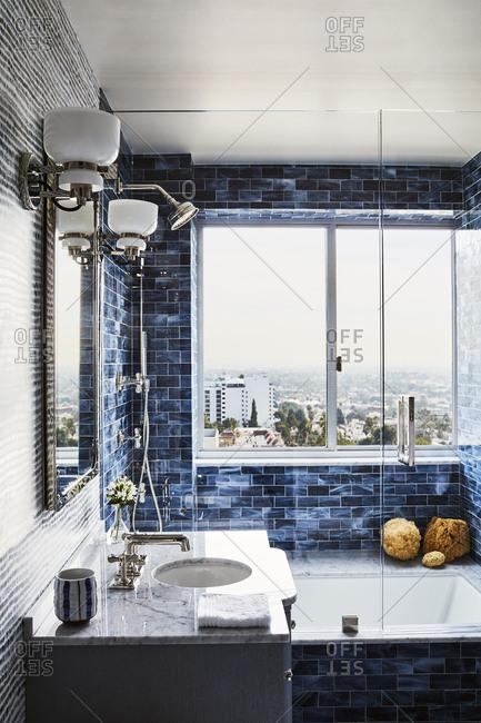Los Angeles, California - November 15, 2016: Blue tiled modern bathroom