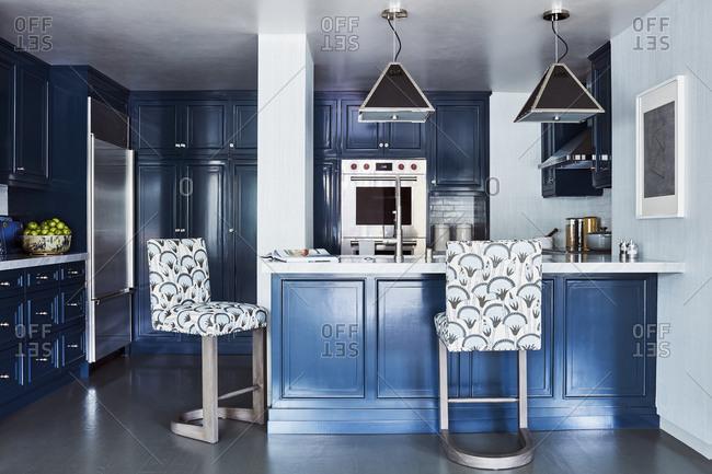 Los Angeles, California - November 15, 2016: Plush bar stools in kitchen area