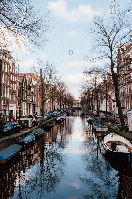Amsterdam, Holland - February 17, 2014: Vertical Amsterdam canal scene